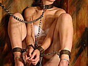 A girl in white underwear all chained up takes a leak in the bowl